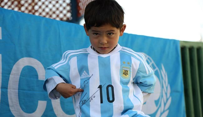 Murtaza with the signed jursey by messi