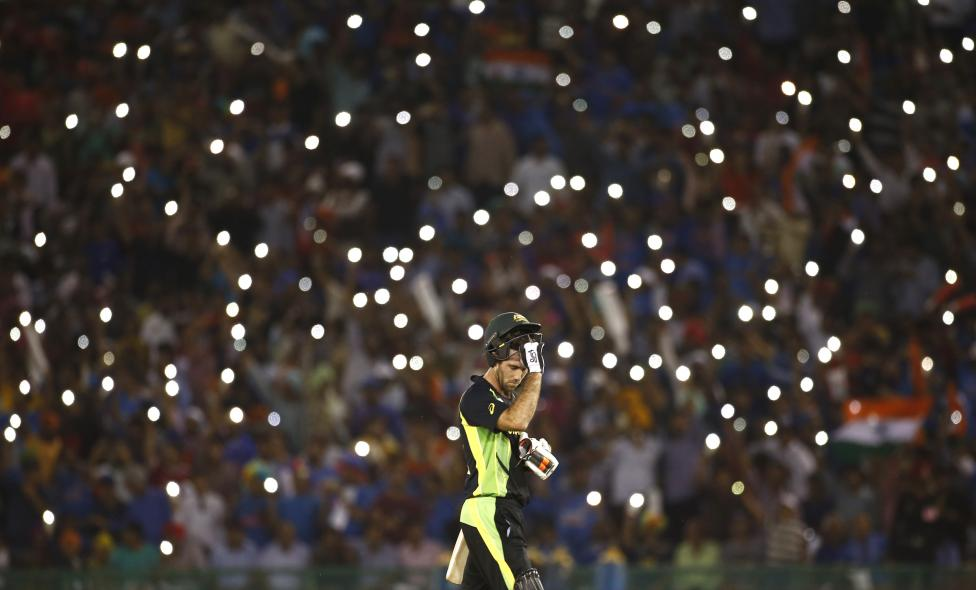 Cricket - India v Australia - World Twenty20 cricket tournament - Mohali, India - 27/03/2016. Australia's Glenn Maxwell takes his helmet off for a drink. REUTERS/Adnan Abidi
