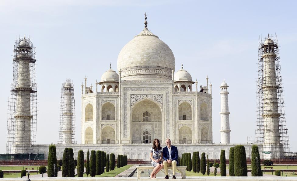 Britain's Prince William and his wife Catherine, the Duchess of Cambridge, pose as they sit in front of the Taj Mahal in Agra, April 16, 2016. REUTERS/Money Sharma/Pool