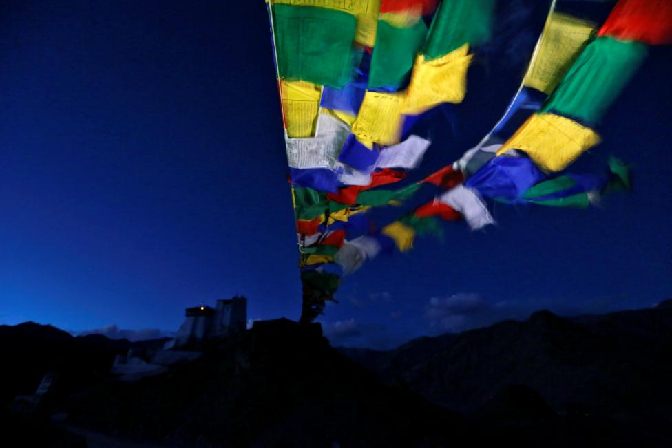 Prayer flags stretch towards Tsemo Monastery in the city of Leh, the largest town in the region of Ladakh, nestled high in the Indian Himalayas, September 26, 2016. REUTERS/Cathal McNaughton