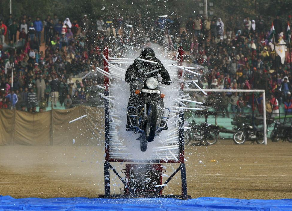 A policeman performs a stunt on his motorcycle during the Republic Day parade in Jammu, January 26 2016. REUTERS/Mukesh Gupta