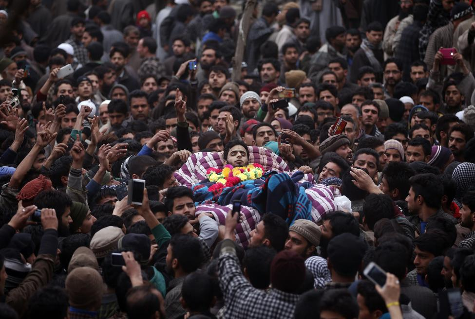Mourners carry the body of Raqib Bashir, a suspected militant, during his funeral in Zadura village, south of Srinagar, February 7, 2016. REUTERS/Danish Ismail
