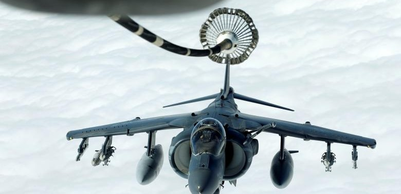 US Marines Harrier AV-8B makes its way to fueling boom suspended from US Air Force KC-10 Extender during mid-air refueling support to Operation Inherent Resolve over Iraq and Syria air space